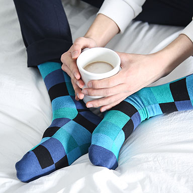 blue square pattern socks and morning coffee